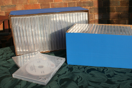27 standard DVD cases fit in each Corning box